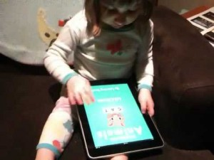 Mary started playing with her doll, and her iPad